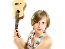 Angry girl fighting with a guitar Royalty Free Stock Images