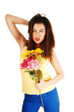 Angry girl with flowers. Royalty Free Stock Images