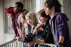 Angry Girl with Friends Looks at Camera. Young attractive teen girl with scene hair looks towards the camera while her friends look away Stock Photos