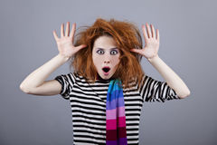 Angry girl with funny hair. Stock Photos