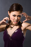 Angry girl growl. Purple spaghetti top gril growl angrily with enamel fingernails Stock Photos