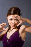 Angry girl growl. Purple spaghetti top gril growl angrily with enamel fingernails Royalty Free Stock Photography