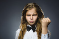 Angry girl with hand up yelling  on gray background. Stock Images