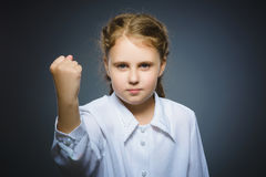 Angry girl with hand up yelling isolated on gray background. Stock Photos