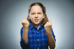 Angry girl with hands up yelling isolated on gray background. Royalty Free Stock Photos