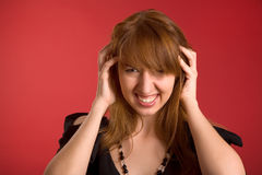 Angry girl with headache Royalty Free Stock Images