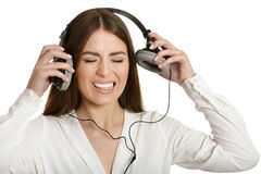 Angry girl and headphones Royalty Free Stock Images