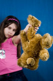 Angry girl holding teddy bear stock photography