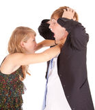 Angry girl knotting the necktie hers boyfriend Stock Photos