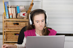 Angry girl with laptop Stock Photography