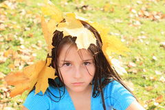 Angry girl with maple leaves Royalty Free Stock Images