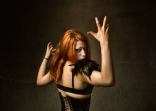 Angry girl. Person in a dark and textured background Royalty Free Stock Photo