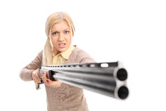 Angry girl pointing a rifle at the camera Royalty Free Stock Images