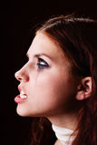 Angry girl portrait. Young angry girl on black background portrait Royalty Free Stock Photos