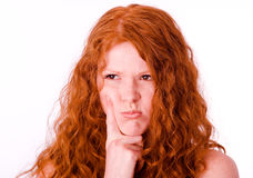 Angry girl with red hair Stock Image