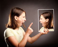 Angry girl screaming to herself Stock Photo