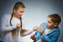 Angry girl shouting at frightened dissatisfied boy. Communication concept Royalty Free Stock Photos