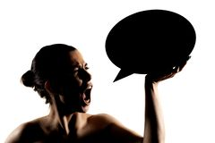 Angry girl with speech balloon. Angry girl screaming at speech balloon, half silhouette portrait bubble dialogue word isolated comics thoughts lady woman clean stock images