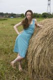 Angry girl standing near haystack Royalty Free Stock Images