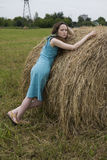Angry girl standing near haystack Stock Photos