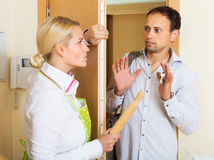Angry girl threatens with rolling-pin Stock Image