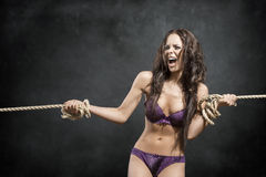 Angry girl tied by rope Stock Images
