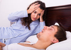 Angry girl tired of loud boyfriend snore Stock Photos
