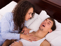 Angry girl tired of loud boyfriend snore Stock Photo