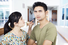 Angry girlfriend pointing at boyfriend at home. Couple fighting at home, girlfriend pointing at her boyfriend stock photos