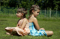 Angry girls. In the garden Royalty Free Stock Image