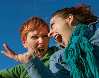 Angry girls stock photos