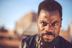Angry good looking young black man in trendy clothes with negati Stock Photo