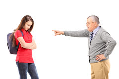 Angry grandfather shouting and pointing with his finger at his n Stock Photography