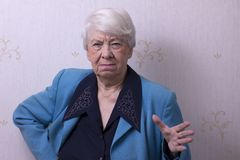 Angry grandma. Gesticulating and looking at the camera Royalty Free Stock Photos