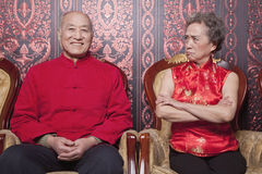 Angry Grandmother and Happy Grandfather in Traditional Chinese Clothing Royalty Free Stock Images