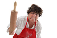 Angry grandmother with rolling pin royalty free stock image