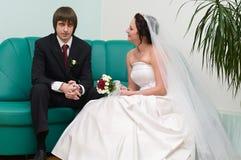 Angry groom and calm bride stock image