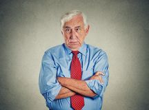 Angry grumpy off senior mature man stock photos