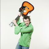Angry guitar hero Royalty Free Stock Photography