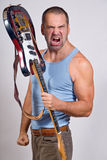 Angry guitarist Royalty Free Stock Photo