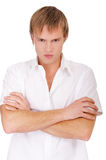 Angry guy. Portrait of angry blond guy on white royalty free stock images