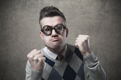 Angry guy with fists raised Stock Photography