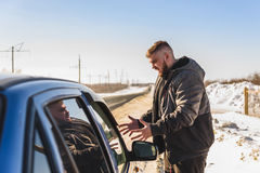 Angry guy near the broken car in Russia. Man angry at the fact that the car broke down Royalty Free Stock Photo