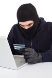 Angry hacker using laptop and credit card Royalty Free Stock Images