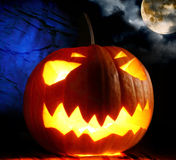 Angry halloween pumpkin and full moon. Single angry halloween pumpkin and full moon Royalty Free Stock Image