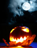 Angry halloween pumpkin and full moon. Single angry halloween pumpkin and full moon Royalty Free Stock Photography