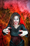 Angry halloween vampire holding out hands Stock Photos
