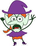 Angry Halloween witch feeling furious and protesting Royalty Free Stock Photo