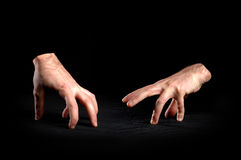 Angry hands. On black background Royalty Free Stock Images