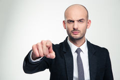 Angry handsome businessman in black suit pointing on you Royalty Free Stock Photos